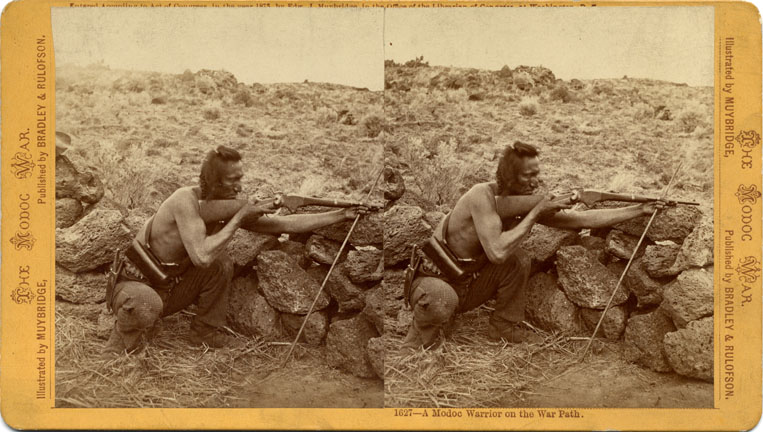 """A Modoc warrior on the war path."" Stereograph by E. Muybridge."