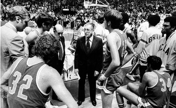 UCLA basketball coach John Wooden, center, talks to his UCLA team.