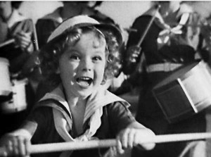 "Shirley Temple in a scene from the movie ""Stand Up and Cheer"" (1934). Photo courtesy of Fox Film Corporation."
