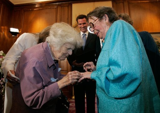 Del Martin and Phyllis Lyon exchange rings as they are married by San Francisco Mayor Gavin Newsom. They were the first couple married in San Francisco as same-sex marriages become legal in California. Photograph by Marcio Jose Sanchez/AFP/Getty Images.