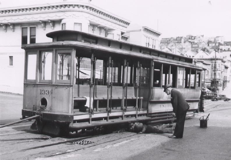 Market Street cable car 133 waiting to be towed to the scrapper. Courtesy Waynee Miller Collection.