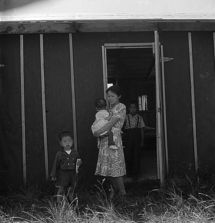 Family in front of barracks, May 19, 1942, Stockton Assembly Center, California. Courtesy of the National Archives and Records Administration. Photograph by Dorothea Lange.