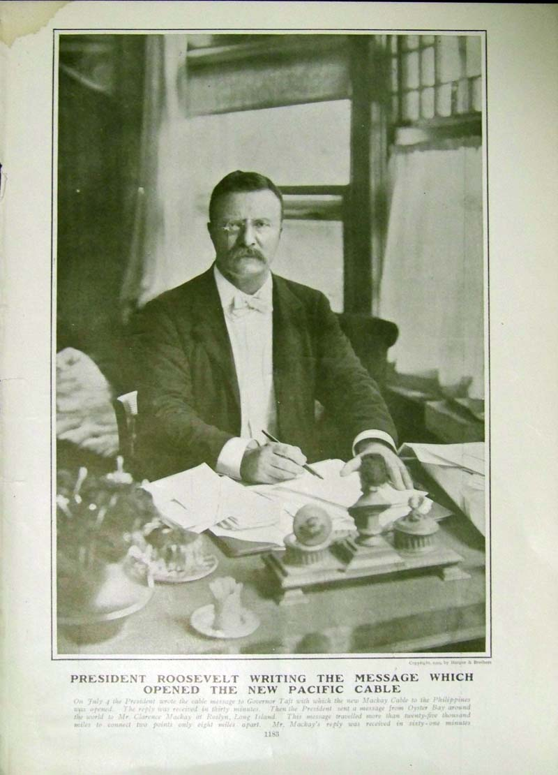 President Roosevelt writing the message that opened the Pacific Cable (1903).