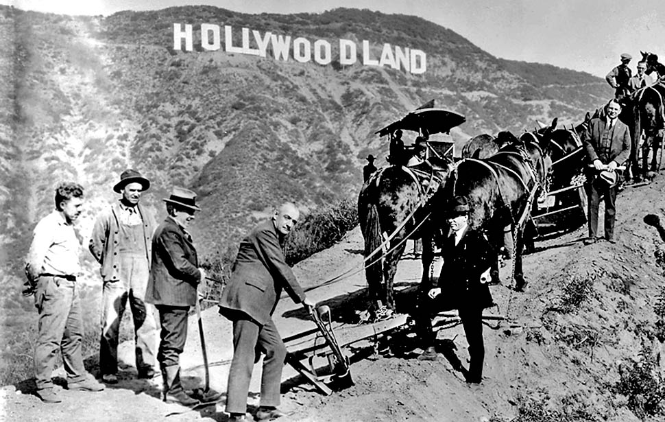 Hollywoodland subdivision groundbreaking publicity photo includes a plow, mules and surveyors.