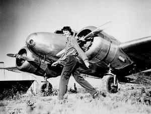 Amelia Earhart and her Lockheed Electra (circa 1937).