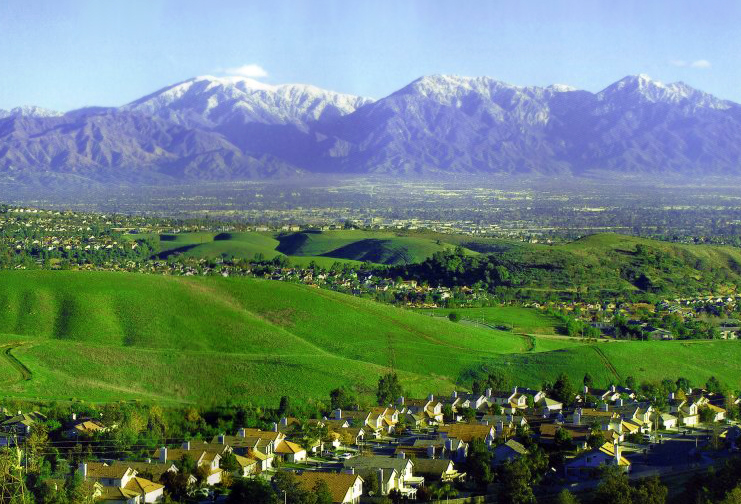 The Chino Hills and skyline of Chino Hills with the Pomona Valley beyond and the San Gabriel Mountains rising in the background.