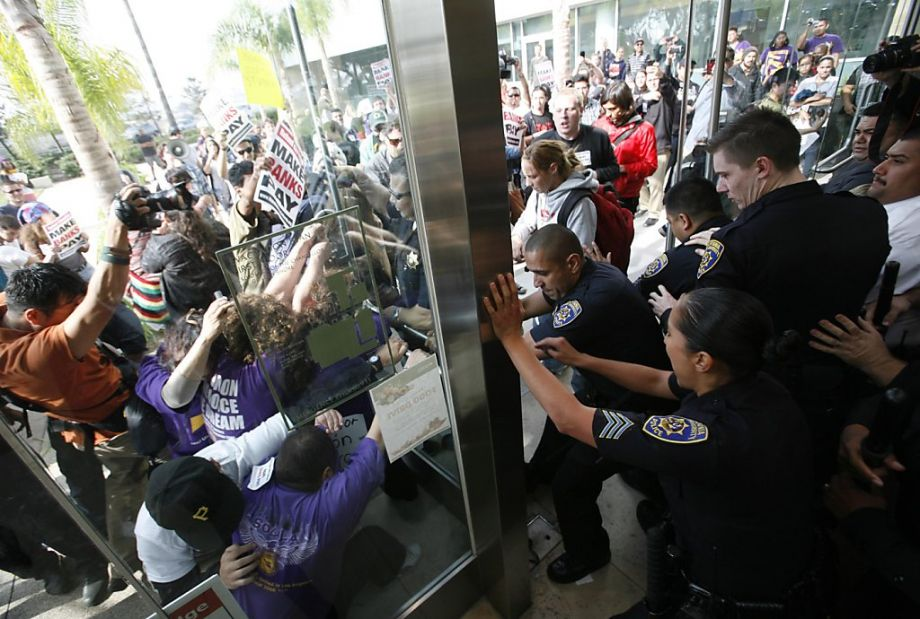 Protestors confronted California State University police after being ejected from the university's board of trustees meeting (2011).