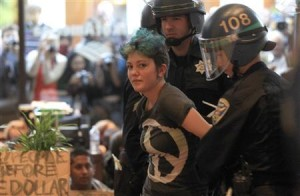 A protester from the Occupy San Francisco movement is arrested by police after the group took over a Bank of America branch in San Francisco (2011).
