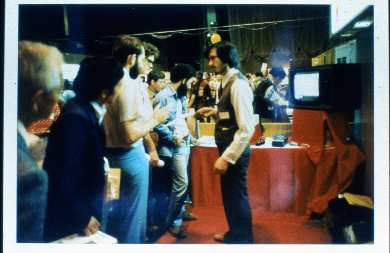 Steve Jobs showing off the first Apple II, probably at West Coast Computer Faire (1977).